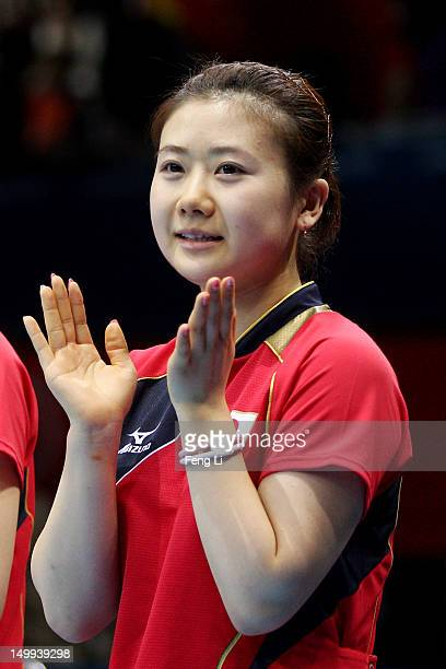 Ai Fukuhara of Japan claps before competing against Xiaoxia Li of China during the Women's Team Table Tennis gold medal match on Day 11 of the London...