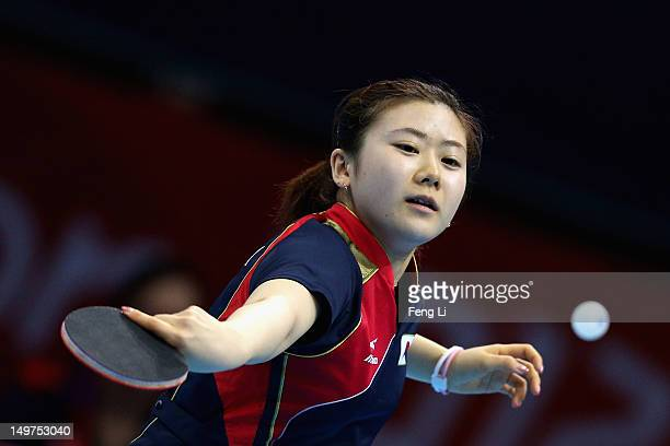 Ai Fukuhara of Japan competes during Women's Team Table Tennis first round match against team of United States on Day 7 of the London 2012 Olympic...