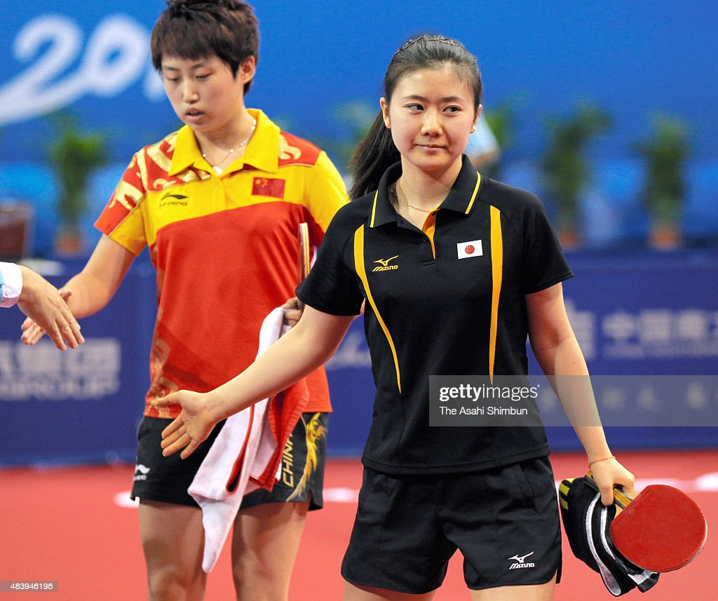 Ai Fukuhara (R) of Japan leaves as she is defeated by <a gi-track='captionPersonalityLinkClicked' href=/galleries/search?phrase=Guo+Yue+-+Table+Tennis+Player&family=editorial&specificpeople=2267823 ng-click='$event.stopPropagation()'>Guo Yue</a> (L) of China in the Table Tennis Women's Singles Semi Final during day eight of the Guangzhou Asian Games at Guangzhou Gymnasium on November 20, 2010 in Guangzhou, China.