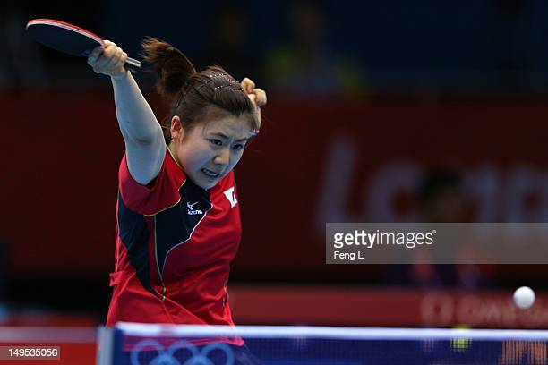Ai Fukuhara of Japan returns the ball during her Women's Singles Table Tennis fourth round match against Jie Li of Netherlands on Day 3 of the London...