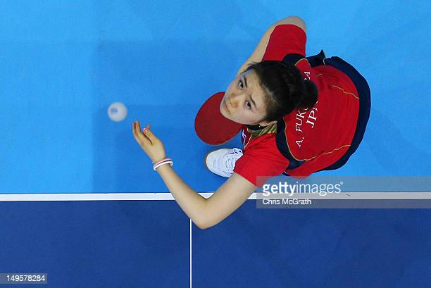 Ai Fukuhara of Japan serves during the Women's Singles Table Tennis quarterfinal match match against Ning Ding of China on on Day 4 of the London...