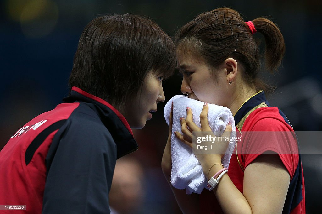 Ai Fukuhara of Japan speaks with her coach during her Women's Singles Table Tennis fourth round match against Jie Li of Netherlands on Day 3 of the London 2012 Olympic Games at ExCeL on July 30, 2012 in London, England.
