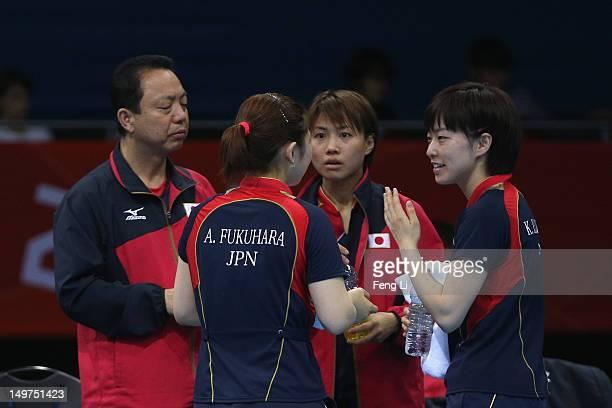 Ai Fukuhara speaks with Kasumi Ishikawa and Sayaka Hirano of Japan during Women's Team Table Tennis first round match against team of United States...