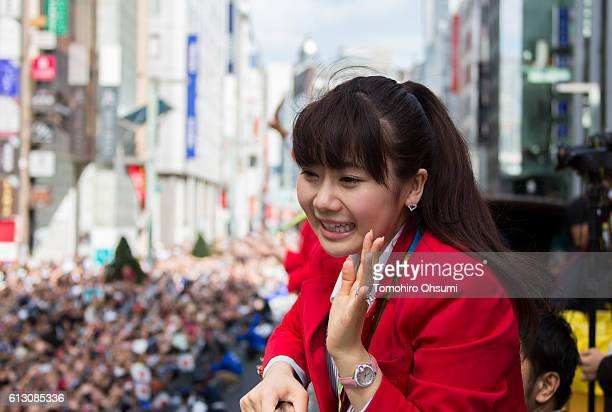 Ai Fukuhara waves from the top of a double decker bus during the Rio Olympics 2016 Japanese medalist parade in the ginza district on October 7 2016...
