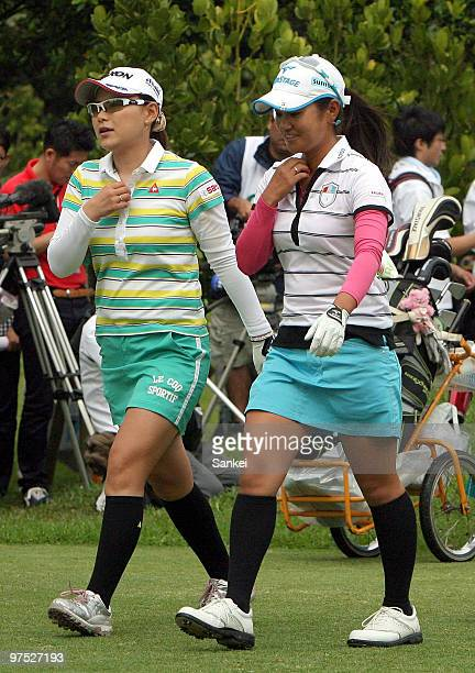 Ai Miyazato and Sakura Yokomine look on during the round one of the 23rd Daikin Orchid Ladies Golf Tournament at Ryukyu Golf Clun on March 5 2010 in...