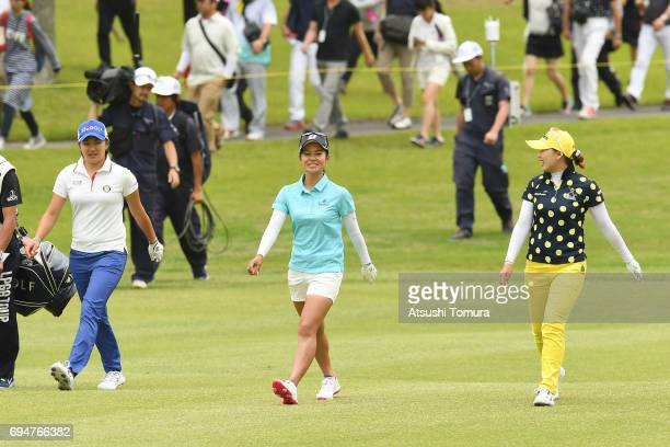 Ai Miyazato of Japan and Misuzu Narita of Japan and NaRi Lee of South Korea smile during the final round of the Suntory Ladies Open at the Rokko...