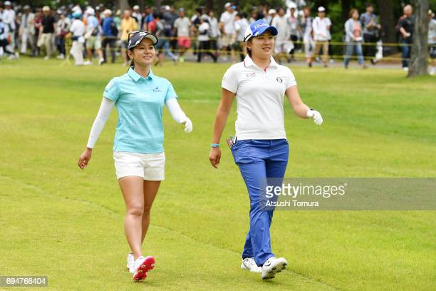 Ai Miyazato of Japan and Misuzu Narita of Japan smile during the final round of the Suntory Ladies Open at the Rokko Kokusai Golf Club on June 11...