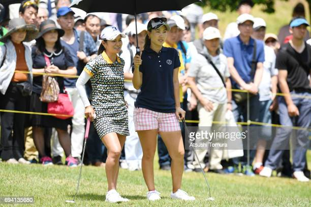 Ai Miyazato of Japan and Momoko Ueda of Japan smile during the second round of the Suntory Ladies Open at the Rokko Kokusai Golf Club on June 9 2017...