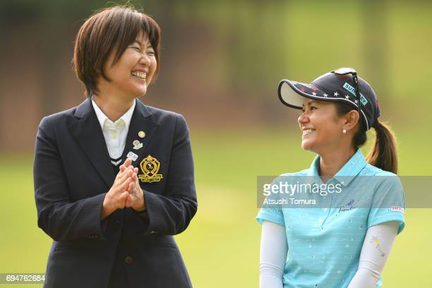 Ai Miyazato of Japan and the chairman of LPGA Japan Hiromi Kobayashi smile during the final round of the Suntory Ladies Open at the Rokko Kokusai...