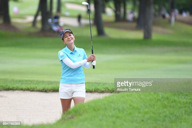 Ai Miyazato of Japan celebrates after chipping in her third shot for birdie on the 12th hole during the final round of the Suntory Ladies Open at the...