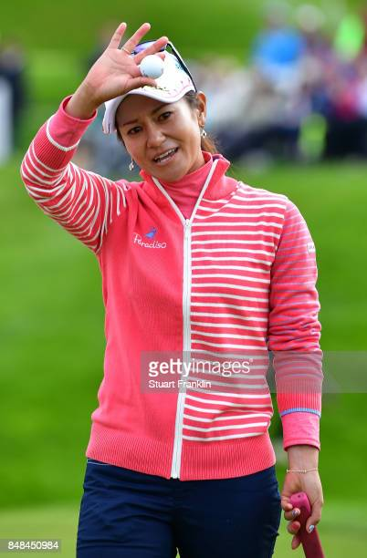 Ai Miyazato of Japan celebrates her putt after her last competative round of golf during the final round of The Evian Championship at Evian Resort...