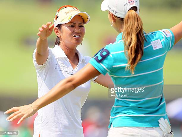 Ai Miyazato of Japan embraces Momoko Ueda of Japan after winning the HSBC Women's Champions at Tanah Merah Country Club on February 28 2010 in...