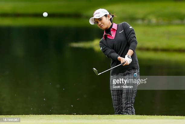Ai Miyazato of Japan hits a pitch shot on the fourth hole during the first round of the Lorena Ochoa Invitational Presented by Banamex and Jalisco at...