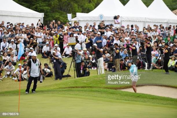 Ai Miyazato of Japan hits from a bunker on the 9th hole during the final round of the Suntory Ladies Open at the Rokko Kokusai Golf Club on June 11...