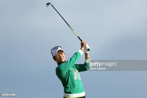Ai Miyazato of Japan hits her second shot on the 4th hole during the first round of the Ricoh Women's British Open at Kingsbarns Golf Links on August...