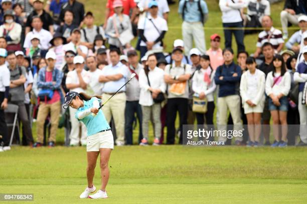 Ai Miyazato of Japan hits her second shot on the 6th hole during the final round of the Suntory Ladies Open at the Rokko Kokusai Golf Club on June 11...