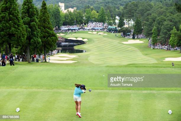 Ai Miyazato of Japan hits her tee shot on the 18th hole during the final round of the Suntory Ladies Open at the Rokko Kokusai Golf Club on June 11...