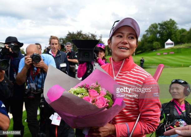 Ai Miyazato of Japan holds flowers that were presented by golfing legend Gary Player of South Africa after her last competative round of golf during...