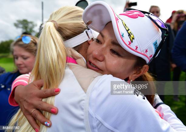Ai Miyazato of Japan is congratulated after her last competative round of golf during the final round of The Evian Championship at Evian Resort Golf...
