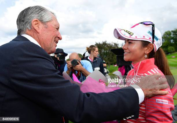Ai Miyazato of Japan is greeted by golfing legend Gary Player of South Africa after her last competative round of golf during the final round of The...