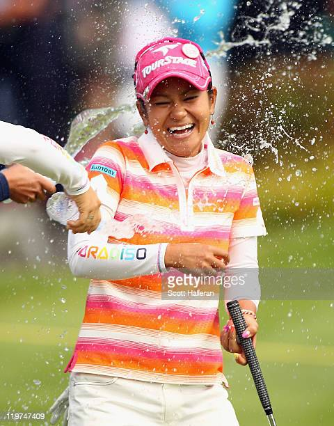 Ai Miyazato of Japan is sprayed with water after her victory at the Evian Masters at the Evian Masters Golf Club on July 24 2011 in EvianlesBains...