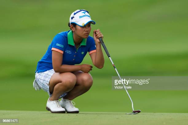 Ai Miyazato of Japan lines up a putt on the 10th green during round two of the Honda LPGA Thailand at the Siam Country Club on February 19 2010 in...