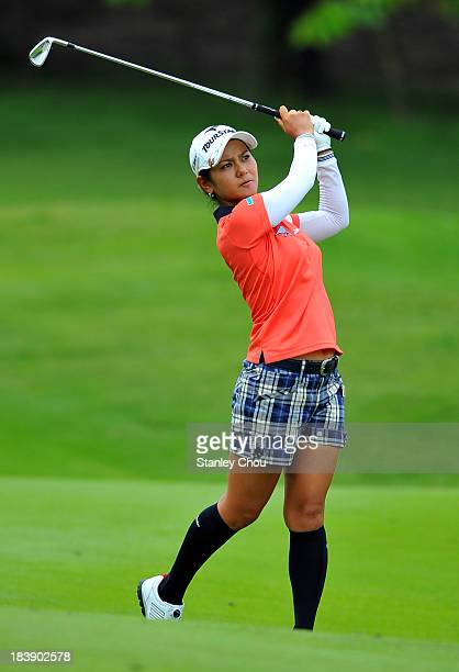 Ai Miyazato of Japan plays her 2nd shot on the 9th hole during day one of the Sime Darby LPGA Malaysia at Kuala Lumpur Golf Country Club on October...
