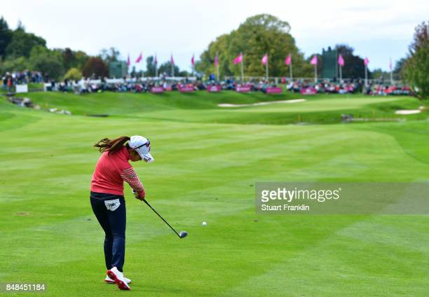 Ai Miyazato of Japan plays her approach shot on the 18th hole during her last competative round of golf during the final round of The Evian...