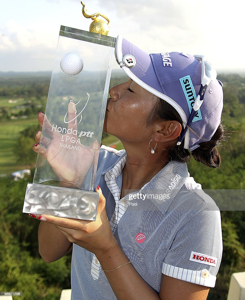 Ai Miyazato of Japan poses with the trophy after winning the final round of the Honda PTT LPGA Thailand at Siam Country Club on February 21, 2010 in Chon Buri, Thailand.