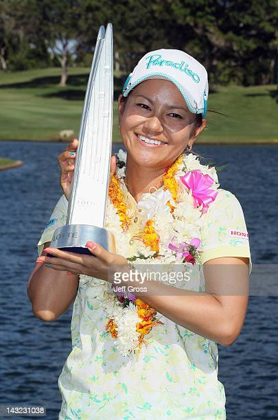 Ai Miyazato of Japan poses with the trophy after winning the LPGA LOTTE Championship Presented by J Golf at the Ko Olina Golf Club on April 21 2012...