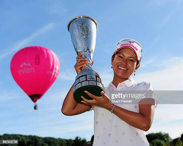 Ai Miyazato of Japan poses with the winners trophy after winning in a playoff against Sofie Gustafson of Sweden during the final round of the Evian...