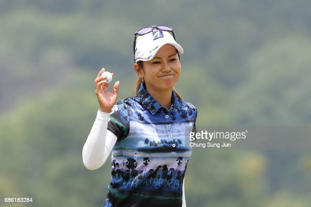 Ai Miyazato of Japan reacts after a putt on the 18th green during the final round of the Chukyo Television Bridgestone Ladies Open at the Chukyo Golf...