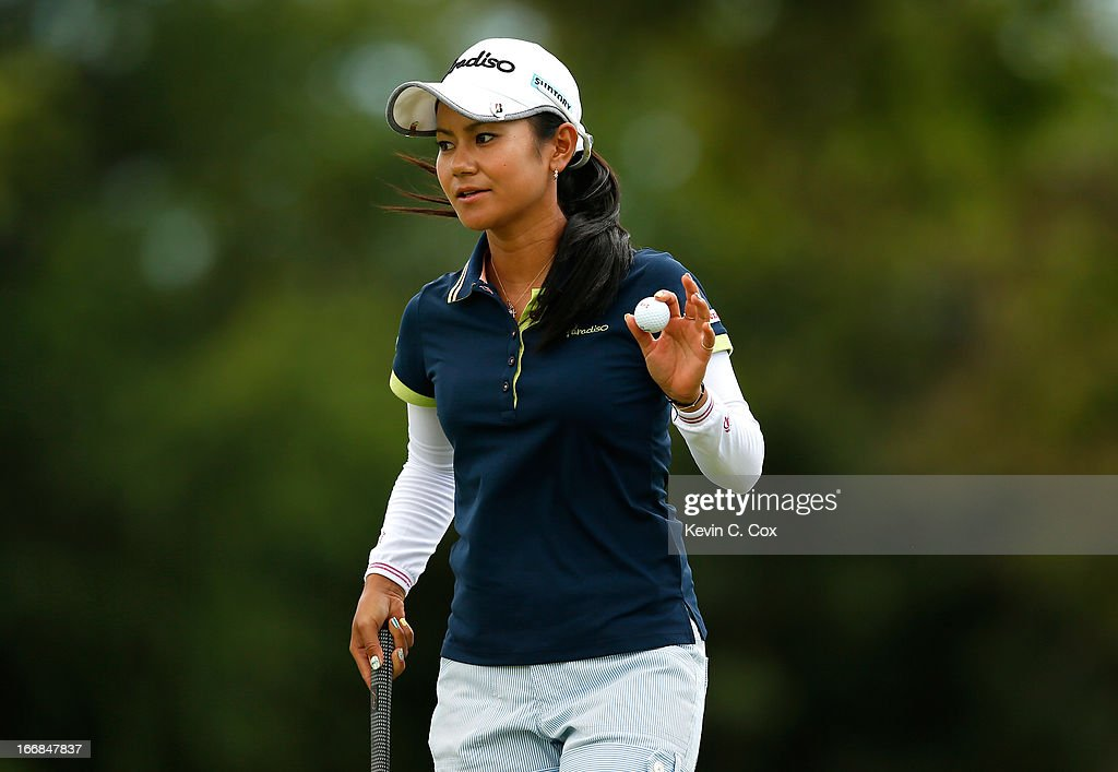 <a gi-track='captionPersonalityLinkClicked' href=/galleries/search?phrase=Ai+Miyazato&family=editorial&specificpeople=210510 ng-click='$event.stopPropagation()'>Ai Miyazato</a> of Japan reacts after her putt on the second green during the first round of the LPGA LOTTE Championship Presented by J Golf at the Ko Olina Golf Club on April 17, 2013 in Kapolei, Hawaii.
