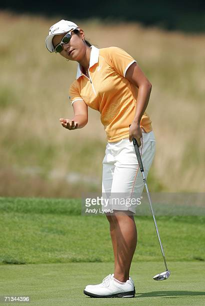 Ai Miyazato of Japan reacts to missing a putt during the first round of the 2006 Women's US Open at Newport Country Club on June 30 2006 in Newport...