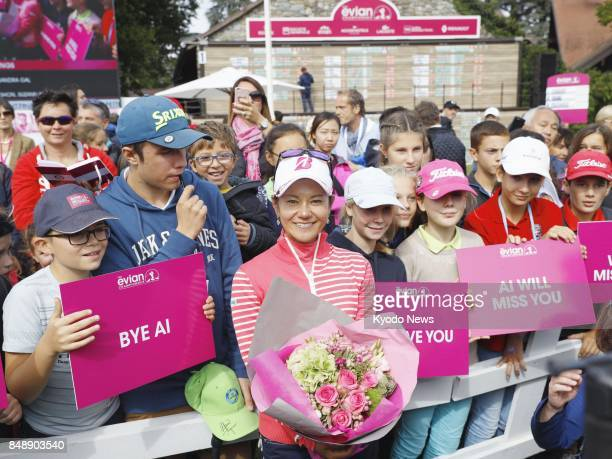 Ai Miyazato of Japan takes a commemorative photo with members of the gallery after completing her career at the Evian Championship in France on Sept...