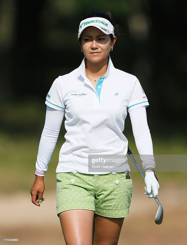 <a gi-track='captionPersonalityLinkClicked' href=/galleries/search?phrase=Ai+Miyazato&family=editorial&specificpeople=210510 ng-click='$event.stopPropagation()'>Ai Miyazato</a> of Japan walks across a green during a practice round prior to the start of the 2013 U.S. Women's Open at Sebonack Golf Club on June 26, 2013 in Southampton, New York.