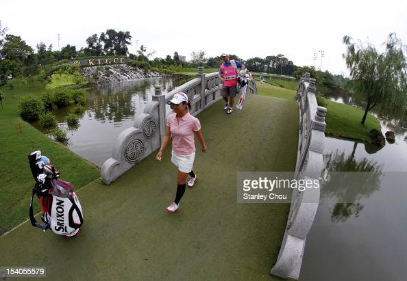 Ai Miyazato of Japan walks to the 16th hole during day three of the Sime Darby LPGA Malaysia at Kuala Lumpur Golf Country Club on October 13 2012 in...