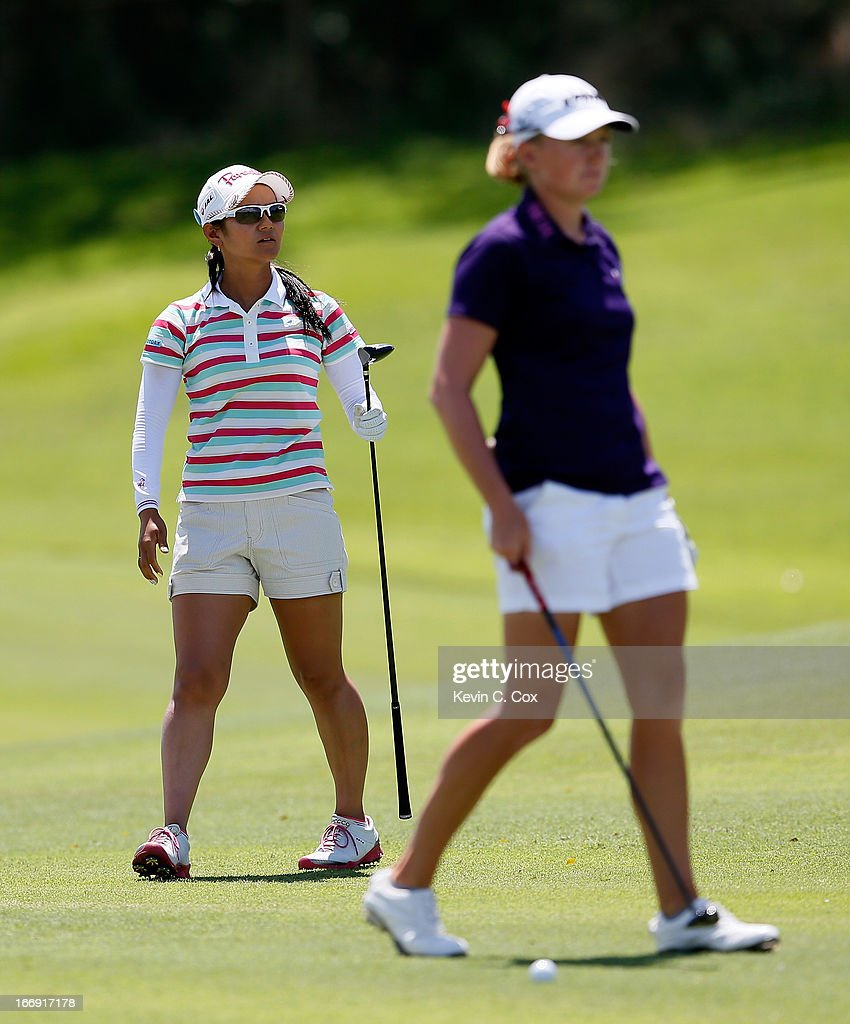 Ai Miyazato of Japan watches her second shot on the fifth hole as Stacy Lewis prepares for her second shot during the second round of the LPGA LOTTE Championship Presented by J Golf at the Ko Olina Golf Club on April 18, 2013 in Kapolei, Hawaii.