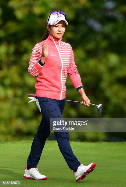 Ai Miyazato of Japan waves as she plays her last competative round of golf during the final round of The Evian Championship at Evian Resort Golf Club...