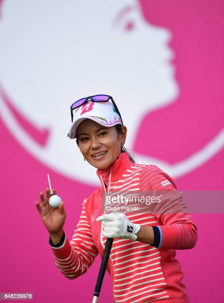 Ai Miyazato of Japan waves to fans as she starts her last competative round of golf during the final round of The Evian Championship at Evian Resort...