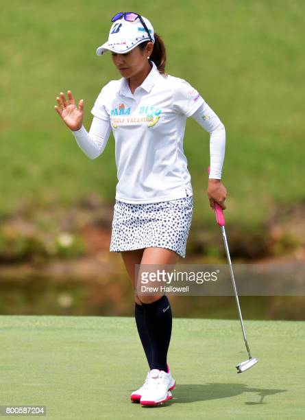 Ai Miyazato of Japan waves to the crowd after a putt on the second hole during the second round of the Walmart NW Arkansas Championship Presented by...