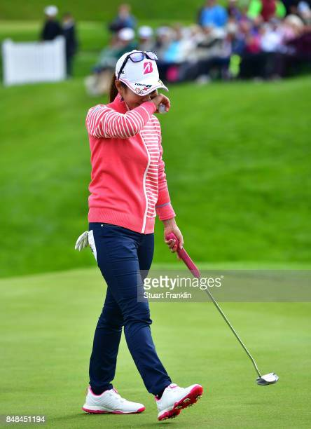 Ai Miyazato of Japan wipes away her tears after her putt after her last competative round of golf during the final round of The Evian Championship at...