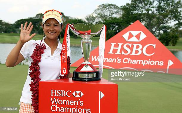 Ai Miyazato of Japan with the winners trophy after the final round of the HSBC Women's Champions at the Tanah Merah Country Club on February 28 2010...