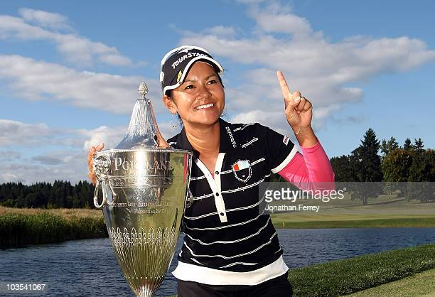 Ai Miyazato poses with the trophy after winning the Safeway Classic at Pumpkin Ridge Golf Club on August 22 2010 in North Plains Oregon Miyazato...