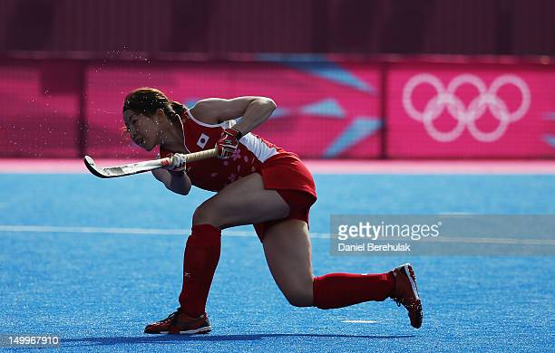 Ai Murakami of Japan shoots to score the winning the golden goal from a penalty in extra time during the Women's Hockey classification match between...