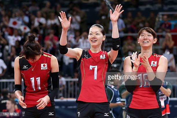 Ai Otomo Kaori Inoue and Yukiko Ebata of Japan celebrate after defeating Korea to win their Women's Volleyball bronze medal match on Day 15 of the...