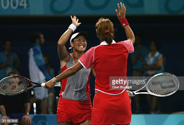 Ai Sugiyama and Shinobu Asagoe of Japan celebrate winning the women's doubles tennis quarterfinal match against Martina Navratilova and Lisa Raymond...