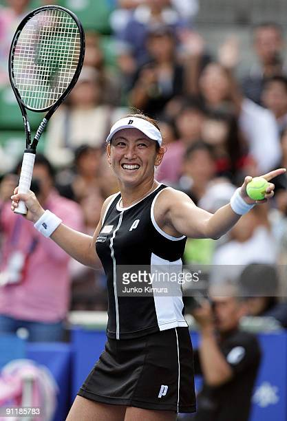 Ai Sugiyama of Japan acknowledges the crowd after playing her doubles match with Daniela Hantuchova of Slovakia against Vania King of the USA and Jie...
