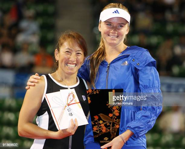 Ai Sugiyama of Japan and Daniela Hantuchova of Slovakia pose with the trophy after playing their doubles final match against Francesca Schiavone of...