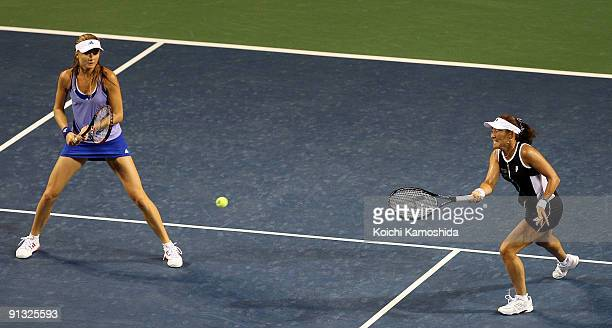 Ai Sugiyama of Japan and Daniela Hantuchova of Slovakia return against Dulko of Argentina and Nadia Petrova of Russia in their double match during...